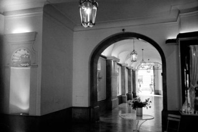 Black and white image of a corridor shot on 35mm film.