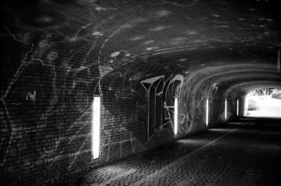 Black and white image of a tunnel shot on 35mm film.